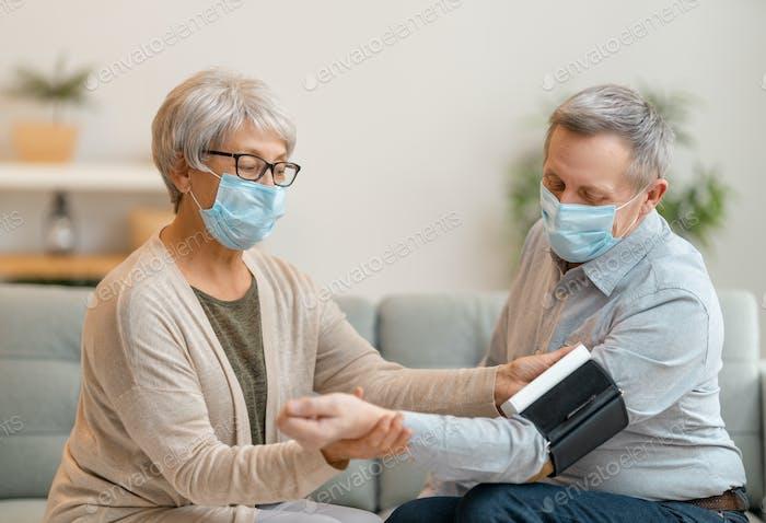 Senior couple wearing face masks