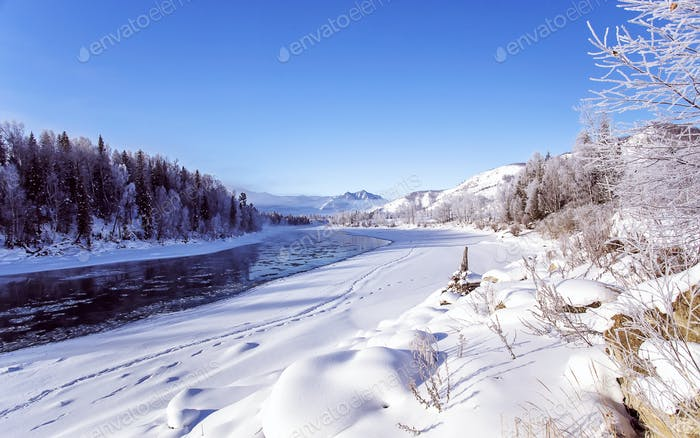Thumbnail for Winter snowy landscape by a river , Russia, Siberia Altai