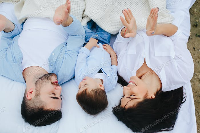 Happy family relaxing together on the mattress