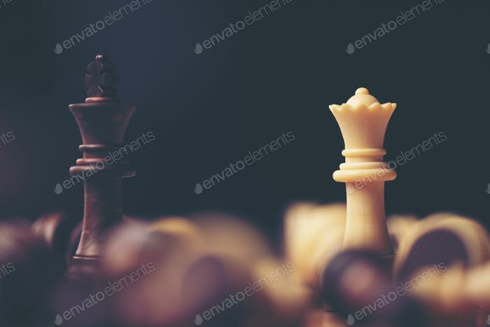 Chess pieces on the board. Black wood background behind.