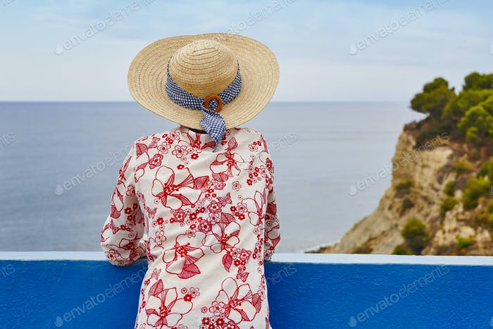 Summer time. Woman with sea and sky background. Relaxing time