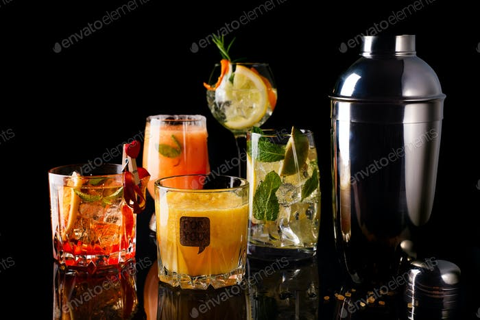 Whiskey-cola cocktail, mojito-cocktail, orange cocktail, strawberry cocktail in glass glasses with