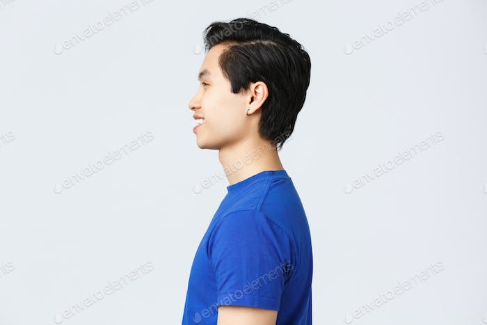 Lifestyle, people emotions and beauty concept. Profile shot of asian hipster guy with earring in