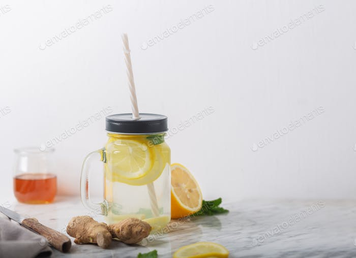 Ginger Water in Glass jar With Lemon and Honey, Horizontal Orientation, White Background, Copy Space