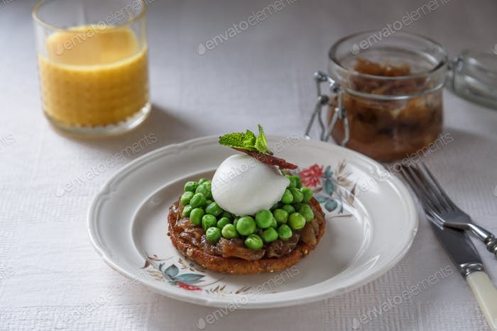 Healthy Breakfast with Wholemeal Bread Toast with Poached Egg and Peas. Orange Juice and onion jam
