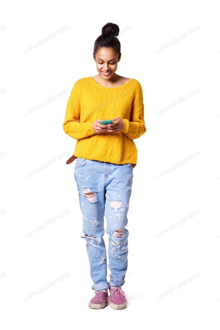 Happy young lady reading text message on her cellphone