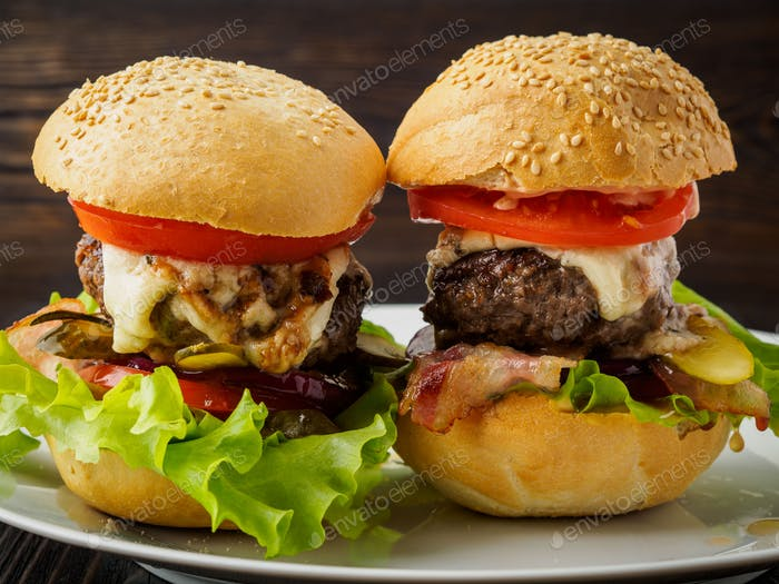 Two delicious homemade hamburgers with beef cutlet