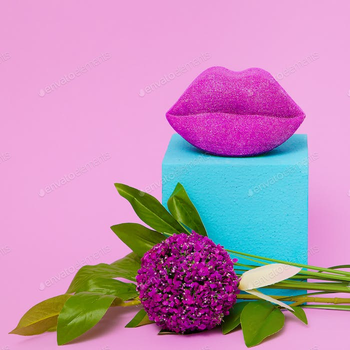 Stylish composition lips and flowers. Beauty concept