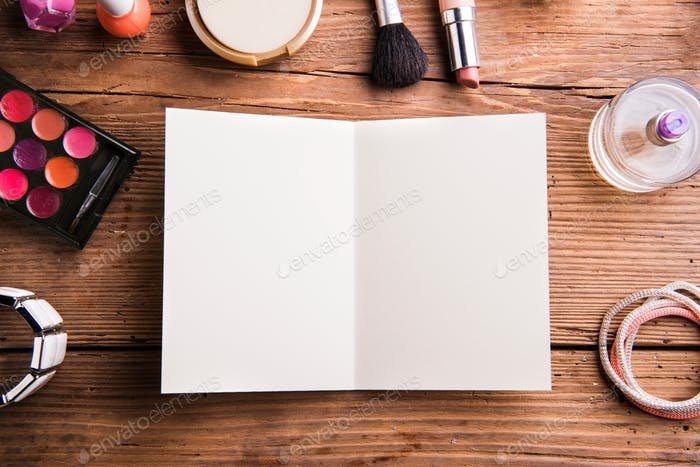 Empty greeting card laid on table. Make up products.