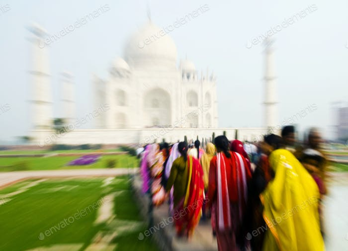 People walking through the Taj Mahal.