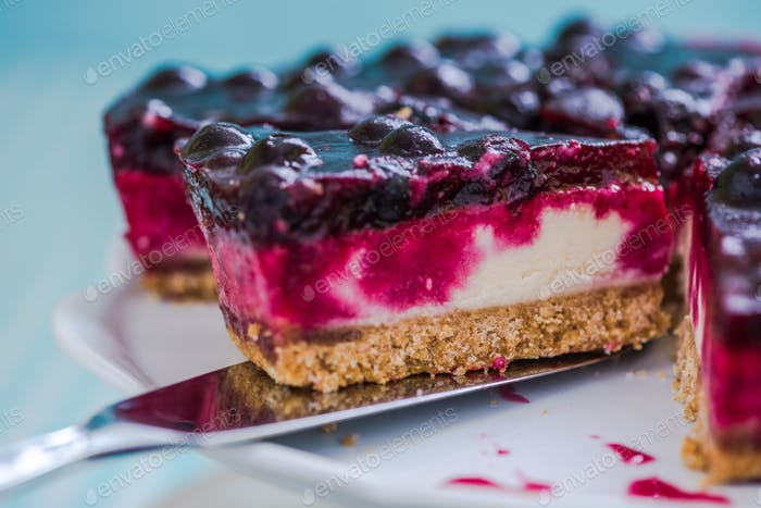 serving cheesecake with black forest fruits
