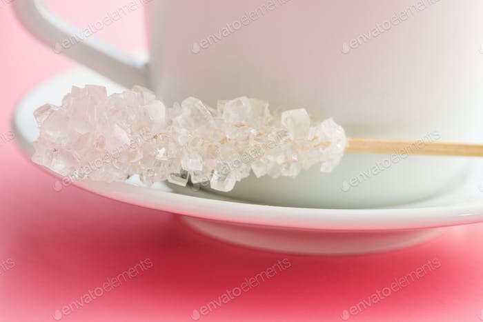 Crystallized sugar on wooden stick.