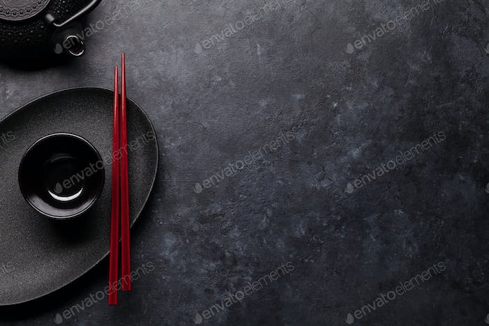 Empty plate, teapot and chopsticks