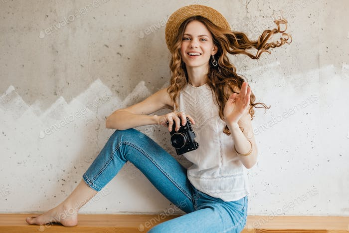 young pretty smiling happy woman wearing blue denim jeans and white shirt