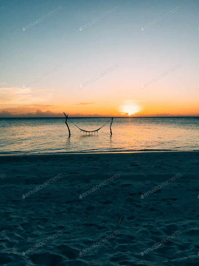 Maldives island luxury beach resort sunset