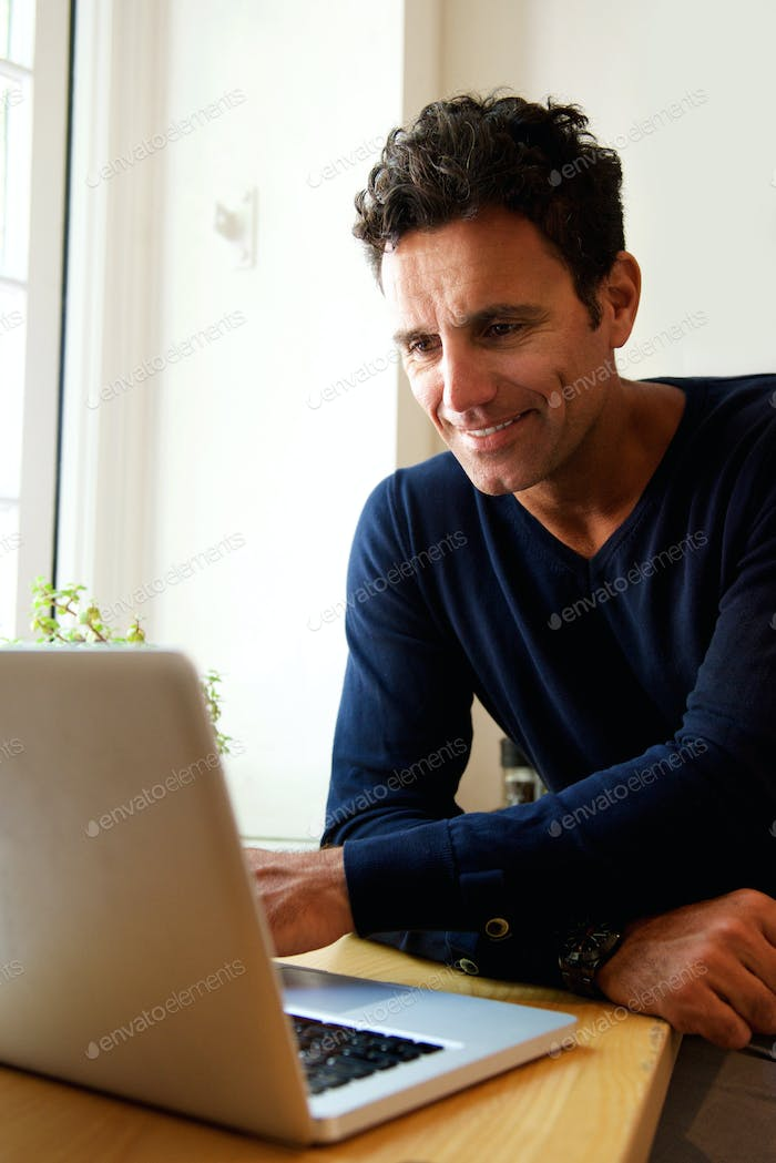Middle aged guy using laptop at home