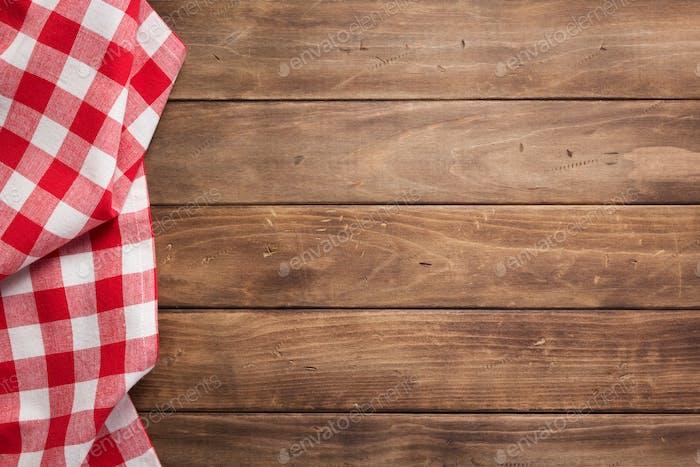 Tuch Serviette auf rustikalen Holzdiele Bord Tisch Hintergrund