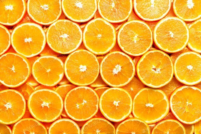 Fresh sliced orange fruit texture. Macro, top view, copy space, banner. Food frame. Juicy oranges