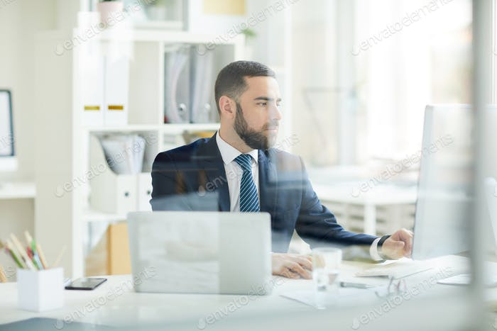 Business analyst making financial forecast