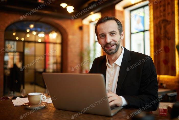 Mature Businessman Working in Restaurant