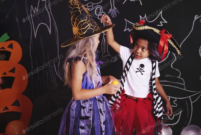 Two girls spending time together at halloween party