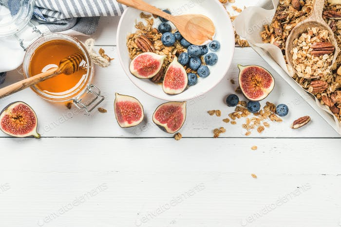 Healthy breakfast set on white wooden background, copy space