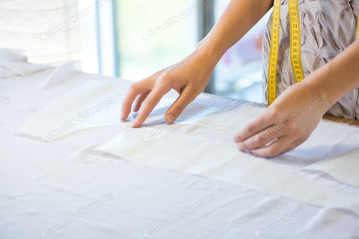 Tailor hands working with fabric