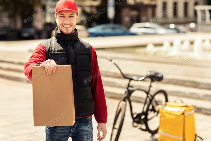 Courier Guy Holding Package Smiling To Camera Standing Outside