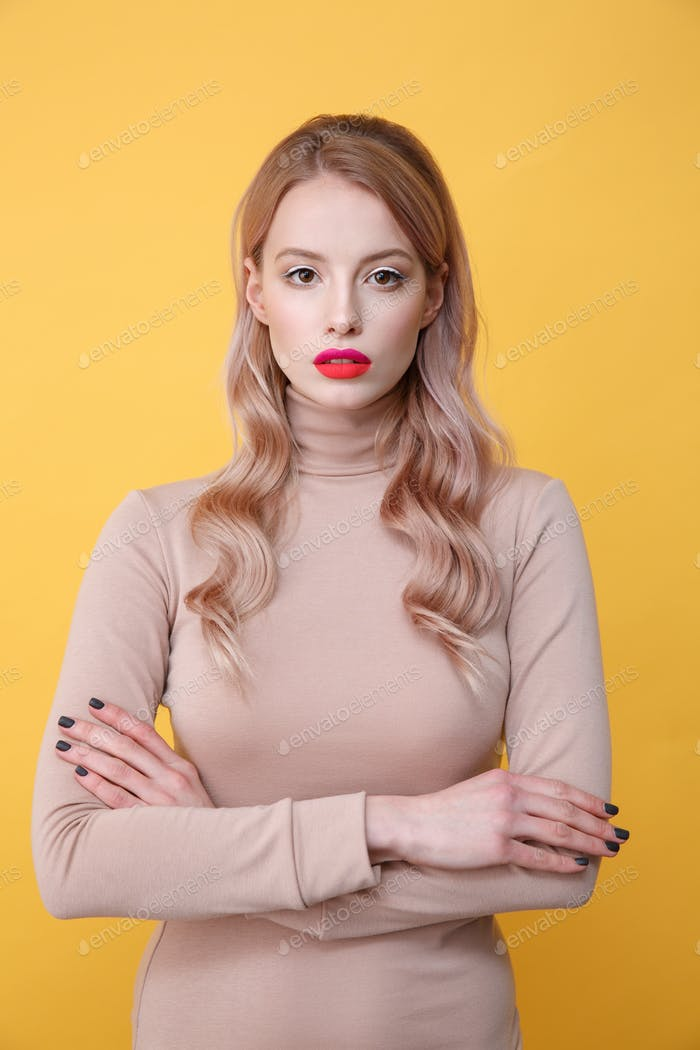 Concentrated young blonde lady with bright makeup lips