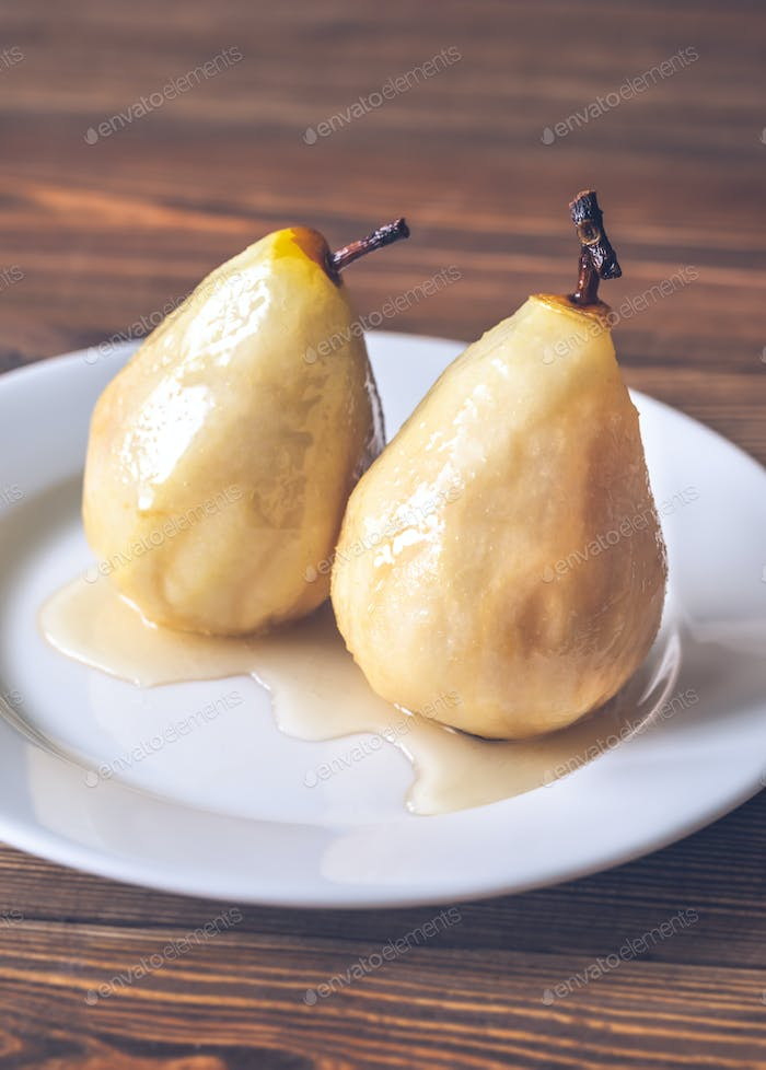 Poached pears on the white plate