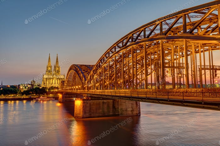 The illuminated Hohenzollern Bridge with the famous Cologne Cathedral