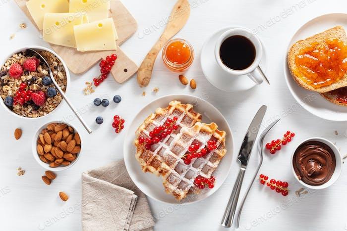 breakfast granola berry nuts, waffle, toast, jam, chocolate spre