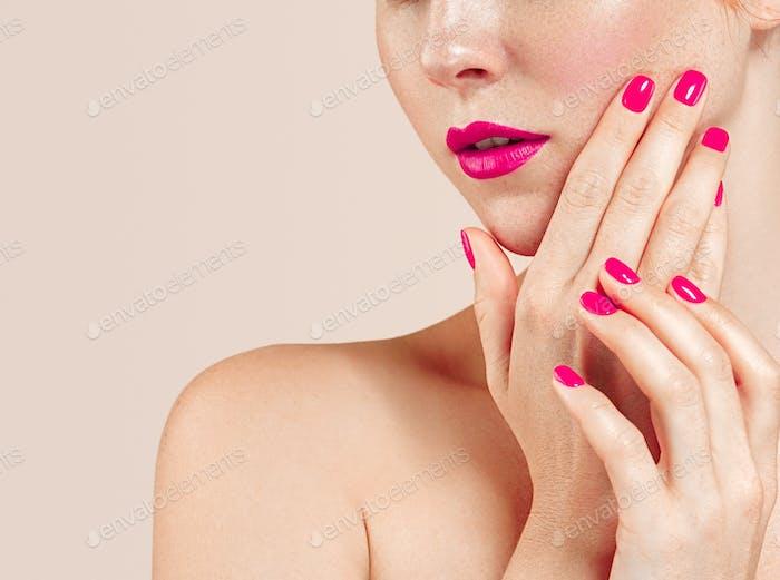 Lips chin cheek. Beautiful woman portrait. Manicure red lips and nails white background