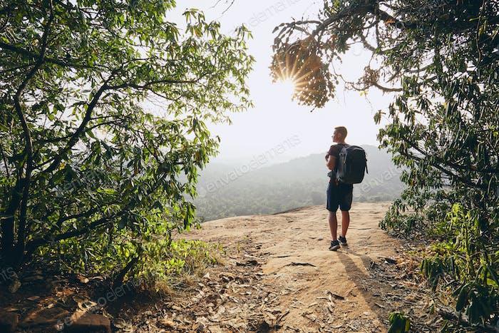 Hiker overlooking view from rock