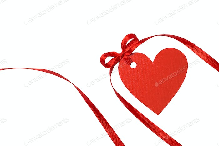 Heart tag with red ribbon