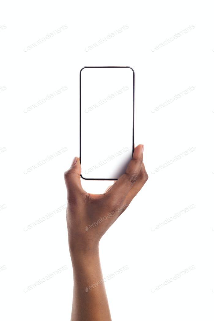 Smartphone with blank screen in black female hand