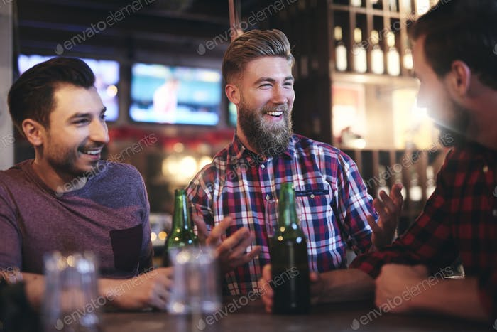 Happy man catches attention of his friend