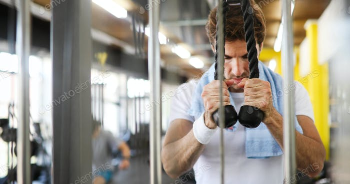 Sport, fitness, bodybuilding, lifestyle and people concept - man exercising in gym