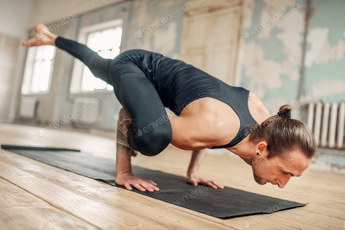 Male yoga doing flexibility exercise