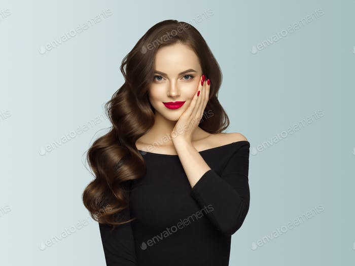 Beautiful hair woman with long brunette hair beauty healthy hairstyle. Gray background. With hands.