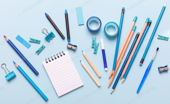 Flat lay of office, school stationery on blue background