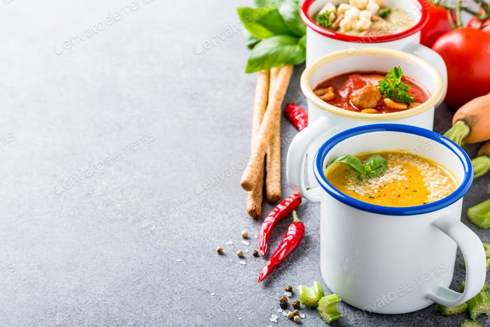 Homemade assorted soups with ingredients
