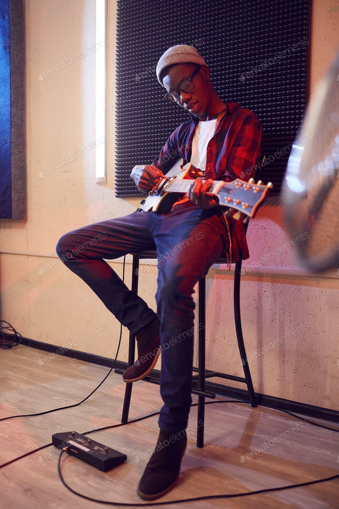 Young African Man Playing Guitar