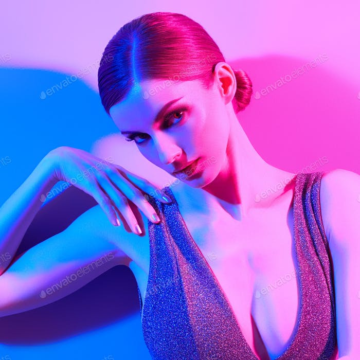 Fashion Woman in neon art light Party disco makeup
