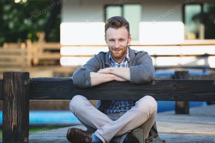 Portrait of handsome young man smiling outdoors