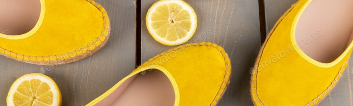 Banner of Yellow espadrilles shoes near slices of lemon