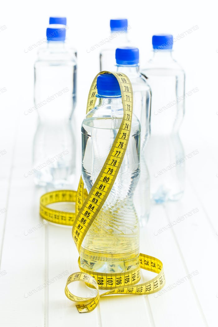water bottle and measuring tape