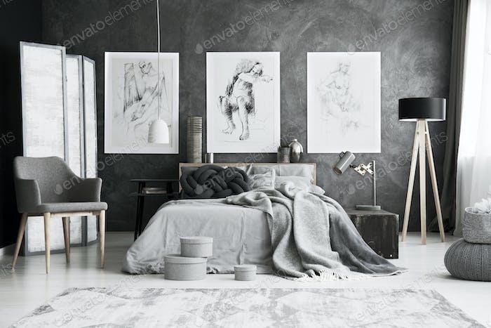 Grey chair in bedroom