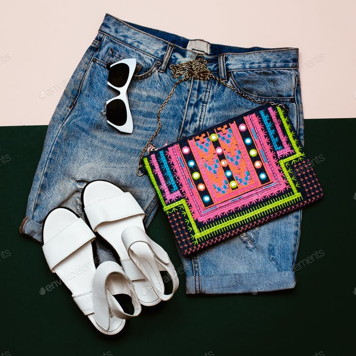 Stylish denim set. Denim shorts sandals and clutch. Bright Summe