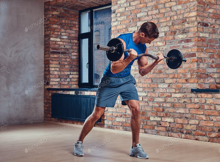 A man holds barbell.